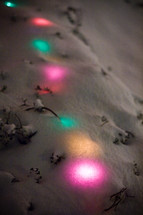Christmas lights under the snow.