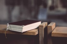 Bible resting on a church pew