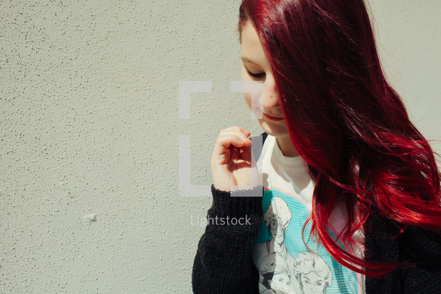 teen girl with bright red hair