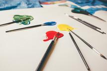 paper, paint brushes, art, paint, tarp, making signs