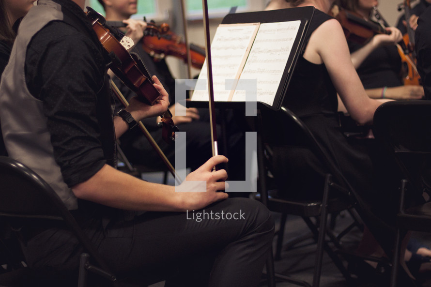 high school orchestra performing