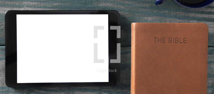 tablet, leather Bible, and coffee cup