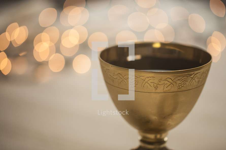 chalice with bokeh lights