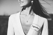 woman with an apprentice name tag