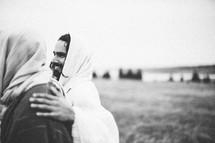 Jesus embracing disciple.