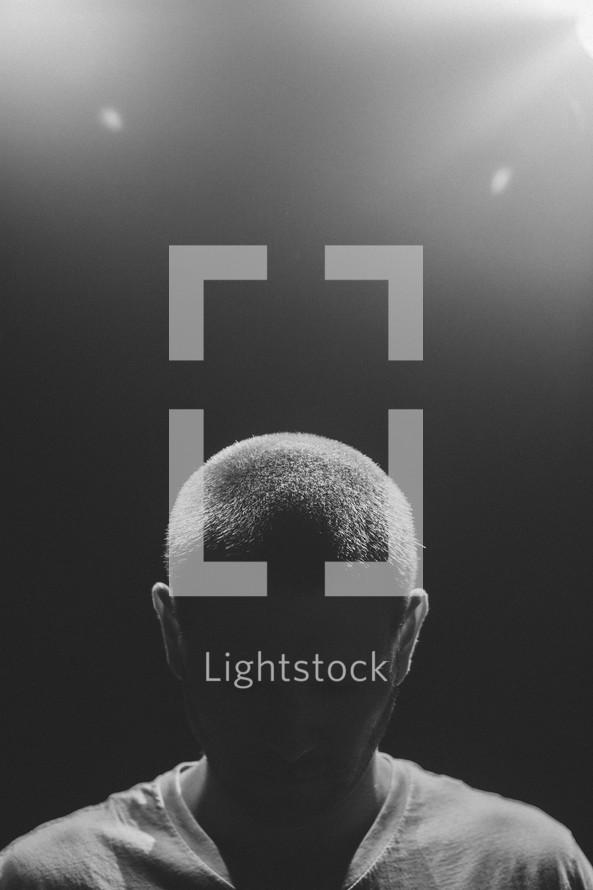 man standing under a spotlight
