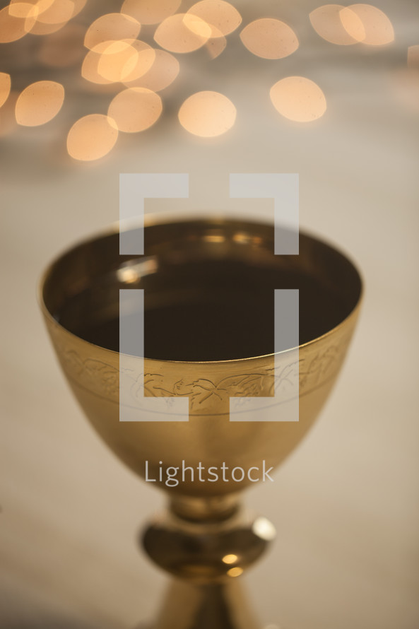 bokeh lights and a chalice