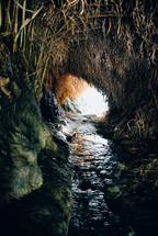 water in a stream in a cave
