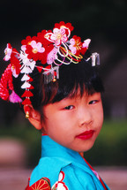 Japanese girl in traditional head dress and clothing