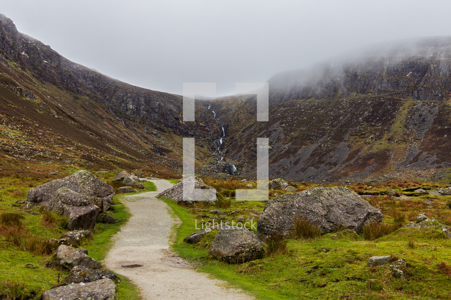 Path winding through a boulder strewn valley leading to Mahon Falls in Waterford County, Ireland