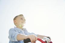 a boy child riding a bike