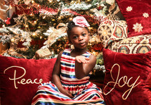 A little girl blowing a Kiss at Christmas