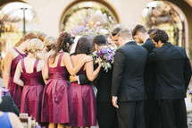 wedding party gathered in prayer