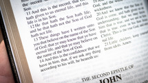 """pages of a Bible - """"These things have I written unto you that believe on the name of the Son of God; that ye may know that ye have eternal life, and that ye may believe on the name of the Son of God."""""""