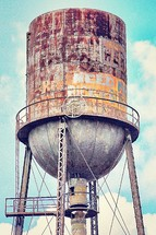 Graffiti-covered water tower.