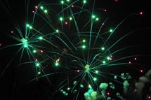 Green Fireworks at night.