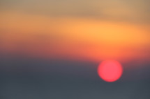 Red sunrise over hazy sea