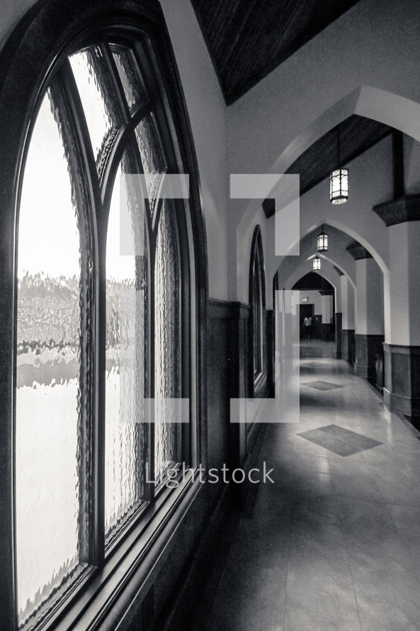 Window and interior arches of a church hallway.