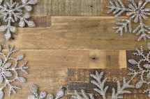 snowflake border on a wood floor background