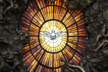 White dove of the Holy Spirit in a stained glass window