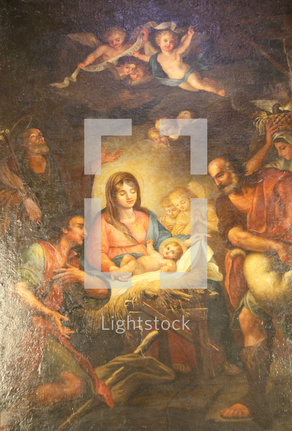Painting of the nativity scene showing Mary, the baby Jesus, angels, Shepherds and Kings in adoration.