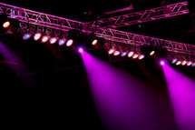 Purple stage lights during a concert