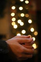 prayer hands with christmas lights