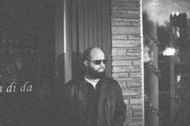 man waiting wearing sunglasses