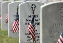 American flags in front of grave markers