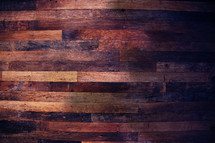 Wood texture plans reclaimed from an old warehouse now cladding in a refurbished hotel.