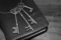 skeleton key on the cover of a Bible