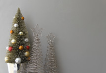 Christmas scene of gold wire Christmas trees and decorated tree with angel and presents