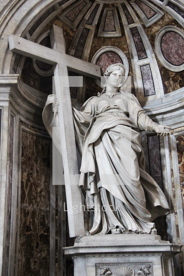 statue of a woman holding a cross