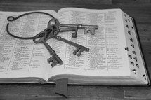 skeleton key on the pages of a Bible