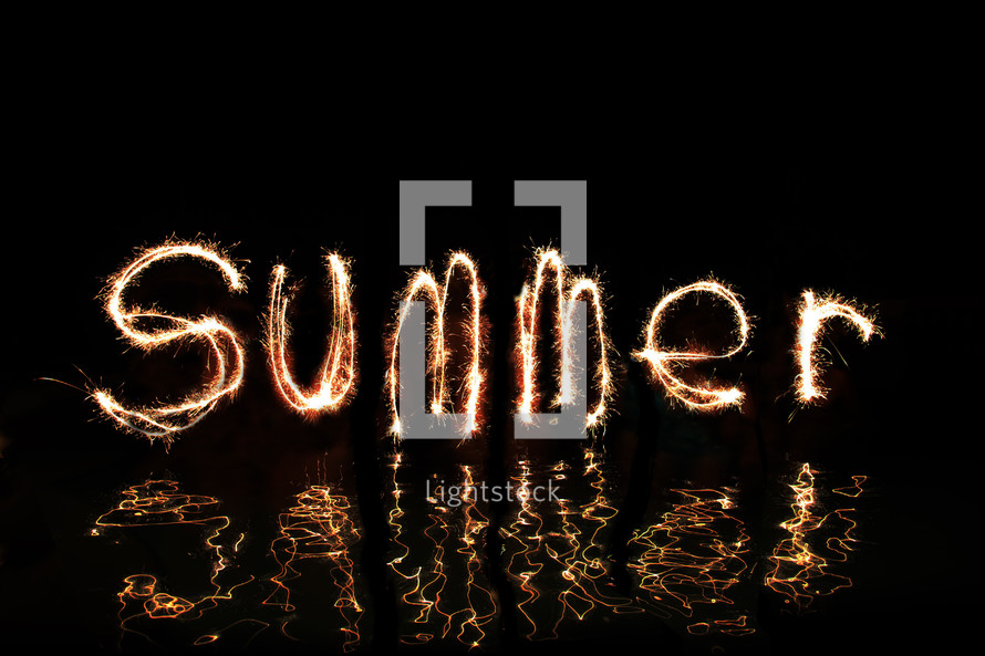 The word 'Summer' written in fireworks  (by five 'artists' standing in waist high water - The middle 'Artist' wrote both letter m's.)