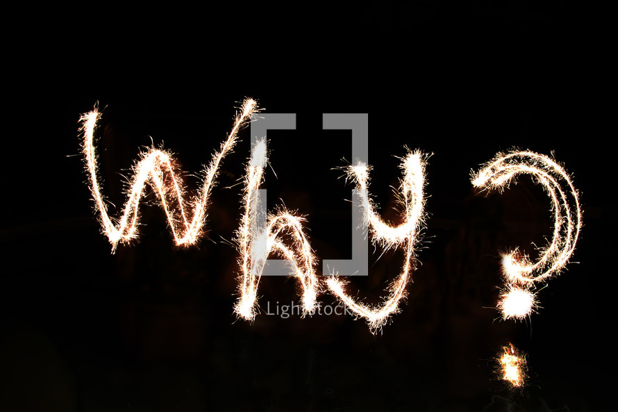 """""""Why"""" written in fireworks by a team of 'artists' waist-deep in water."""