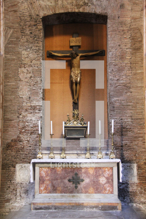 Crucifix at an altar