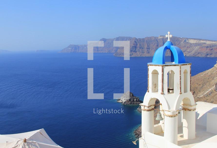 coastline and church in Greece. Bell tower overlooking Mediterranean Ocean