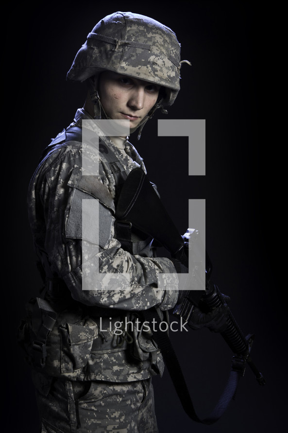soldier holding a rifle