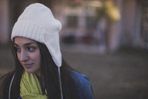 A young woman wearing a white beanie