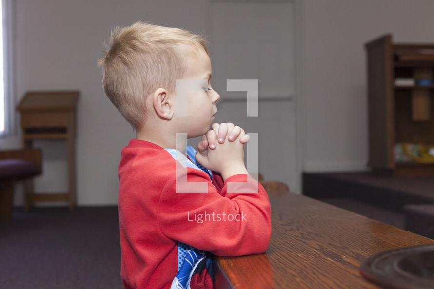 boy child in prayer