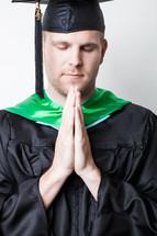 Graduate praying.