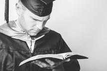 Gradutae reading the Bible.