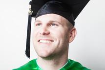 Smiling graduate.