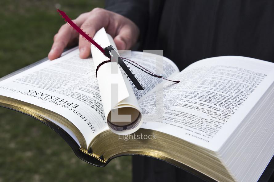 diploma on a Bible