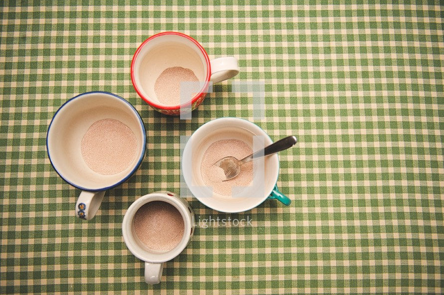 spoon in a mug of powered hot cocoa