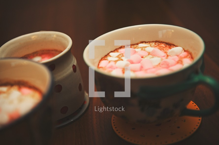 marshmallows in mugs of hot cocoa