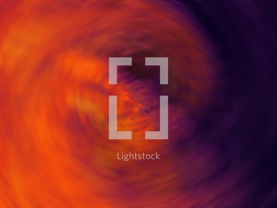 Spiral of bright orange and purple light.