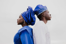African, ethnic, traditional clothing, man, woman, couple, standing back to back