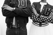 couple in 1950's letter jackets
